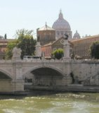 A view across the tiber river to St. Peter's