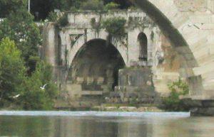 Ancient Roman bridge on the river Tiber in Rome