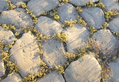 A major Roman invention was road construction using hard paving stones to provide durability.