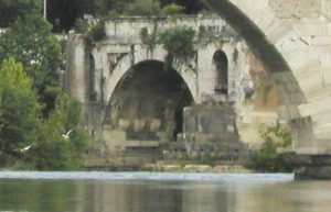Ancient Roman bridge on the river Tiber in Rome
